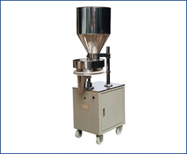 SEMI AUTOMATIC VOLUMETRIC CUP FILLING MACHINE